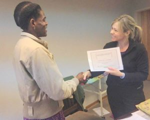 Gabusile receiving her certificate from Gemma