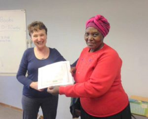 Teresa receiving her certificate from Marysia