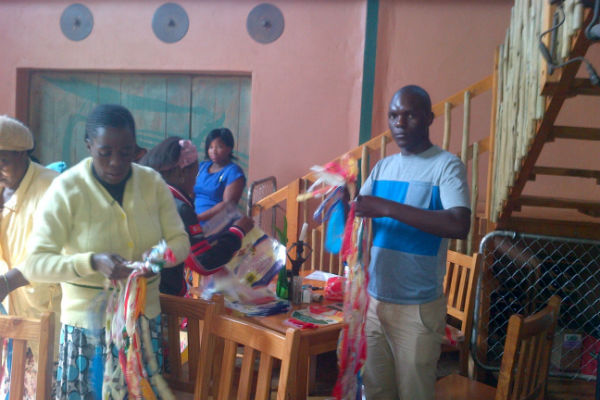 The Teachers learning to make skipping ropes from Plastic Bags
