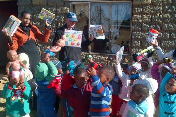 Children at Siblisisie school receiving their toys and puzzles