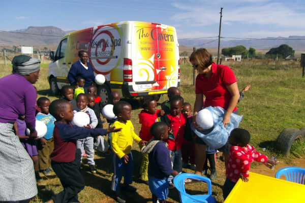 Daphne giving out some balls at Emseni school