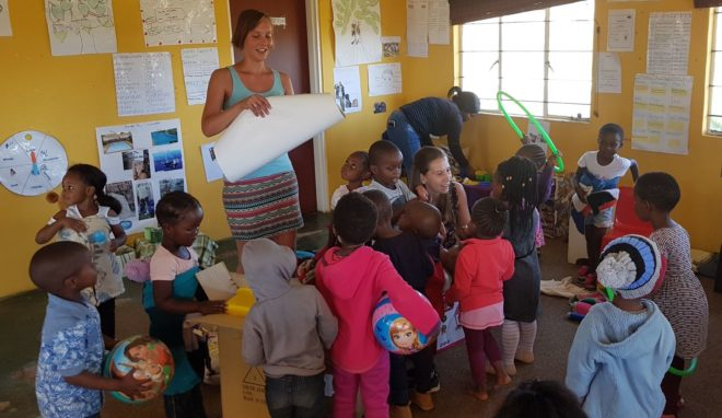 Typhaine and Anke issuing toys at Sbusisiwe