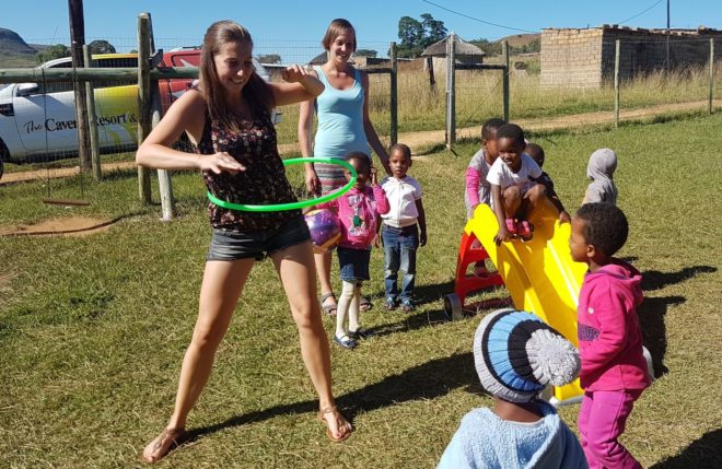 Typhaine and Anke playing with the Children at Sbusisiwe