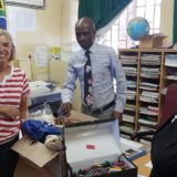 Daphne giving Stationery to Isukangihlale Primary