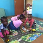 Children enjoying the new play mats sponsored by Georg and Gertrud.