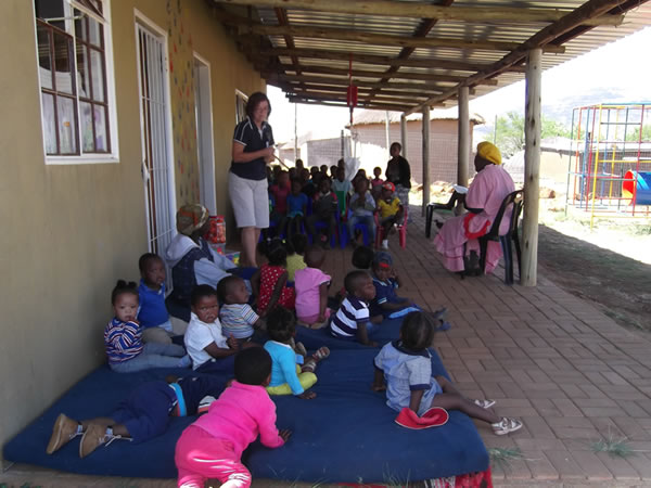 Gogo (Grandmother) reading to some of the Siqalakuhle children